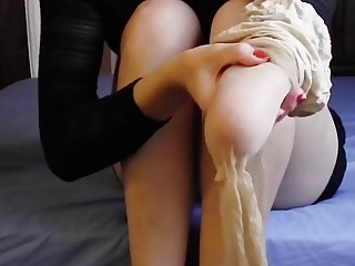 Amputee lady is putting on pantyhose and being seductive