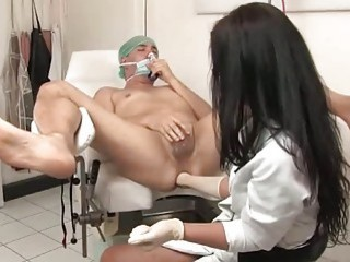 Sexy nurse examining his asshole