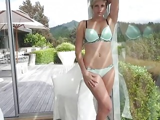 Hot blonde is masturbating passionately for you