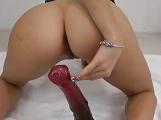 Sensational blonde with nice tits rides a massive toy