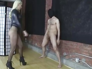 Pretty girl in fishnets kicking his balls