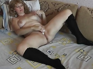 Sexy milf is home masturbating with a fidget spinner