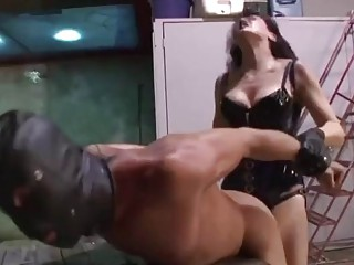 Femdom with a strapon fucking his ass