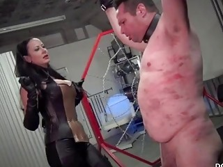 Dominant mistress whipping her horny man