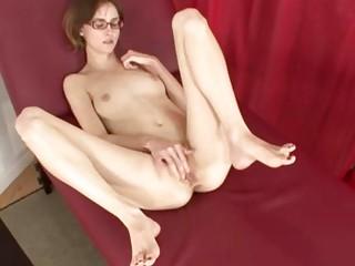 Skinny bukkake bitch masturbates and shows her feet on sofa