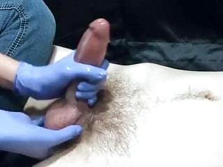 Female casting agent with blue gloves jerks off hairy dong
