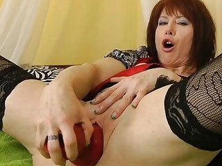 Brutal mature woman double penetrates her holes with some dildos