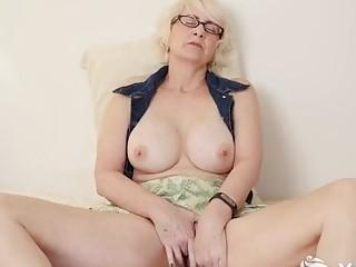 Curvy mature granny masturbates slowly while thinking about hardcore sex