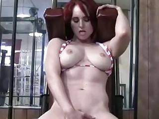 Fit redhead is masturbating and exercising