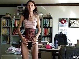 Anorexic brunette with a tiny waist posing