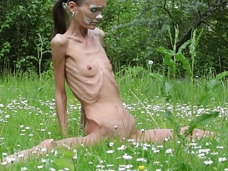 Anorexic chick is happy to pose for us naked outdoors