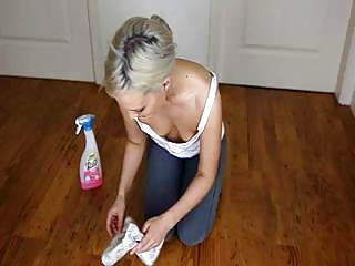 Downblouse cutie teases with her small tits while cleaning house