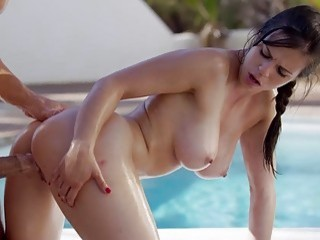 Attractive babe with big tits gets dicked by the pool