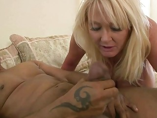 Big breasted MILF has interracial anal sex on the bed
