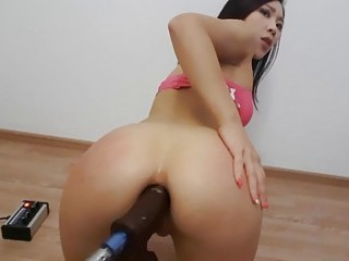 Asian babe playing with her fuckmachine