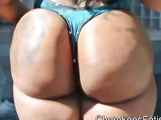 Hot black babe with big ass teasing beside the pool