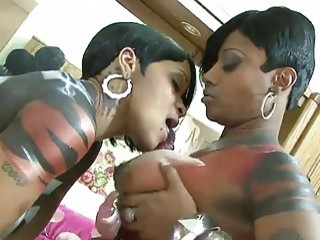 Busty lesbians pleasuring each other's pussies