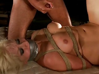 Blonde MILF gets pleasured by some horny studs