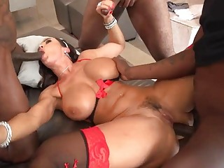 Slut with big tits in stockings gets gangbanged
