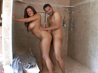 Ebony couple fucks in various positions while showering