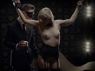 Tied-up blonde receives pleasure from her master