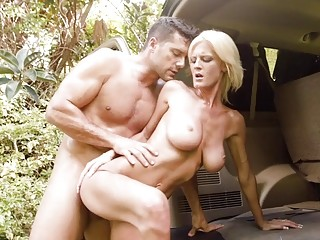 Blonde with big tits takes a stiffie inside of her