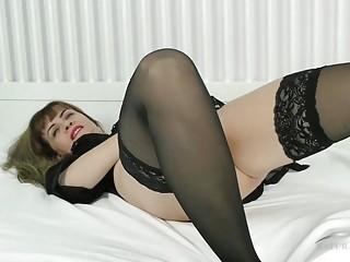 Horny mature naughty gets naked and enjoys toying and masturbation