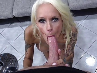 Tattooed MILF adores big dick in her mouth and pussy