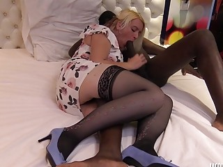 Sluty MILF in stockings sucks and enjoys hardcore interracial fuck